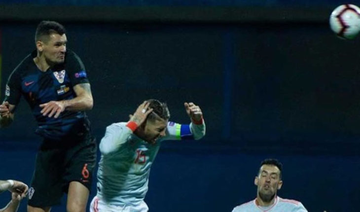 Croatian footballer Lovren mocks Sergio Ramos after a nudge to hit during the Spain