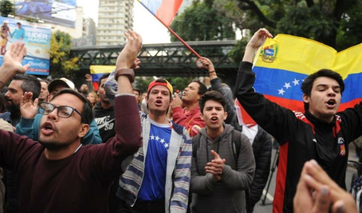 Two detainees and an injured man after a protest at the Venezuelan Embassy in Argentina