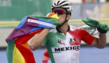 Mexican speed skater celebrates his bronze waving the gay flag