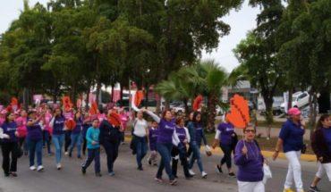 Ahomenwomen march for Iternational Women's Day