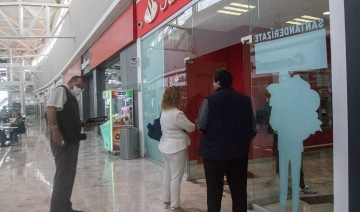 Santander cashiers hold user cards