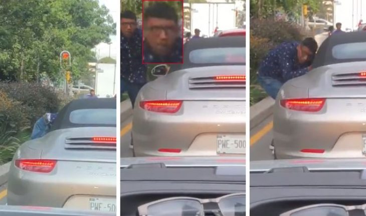 Thief assaults driver during red light (Video)